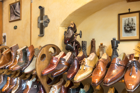 FLORENCE, ITALY, MAY 04, 2018: Fashion classical polished mens handmade shoes selling in shop in Florence