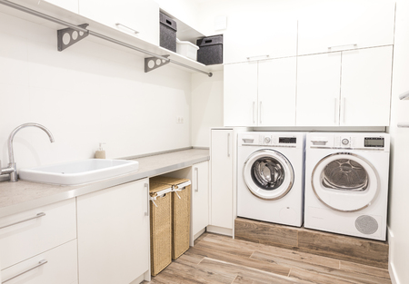 Laundry room with washing machine in modern house Stok Fotoğraf