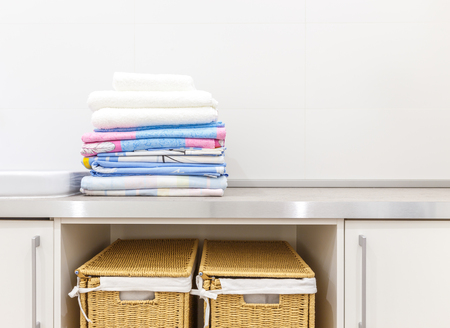 Modern white laundry room with two baskets Stock Photo