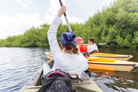 Tourist kayaking in mangrove forest in Everglades Florida, USA