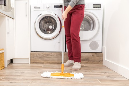 Cleaning floor in laundry room in modern house Stock Photo - 115861739