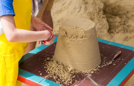 Sand castle made by kids on a craft lesson on beach