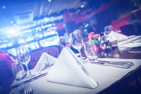 Fine table setting with blue light flare
