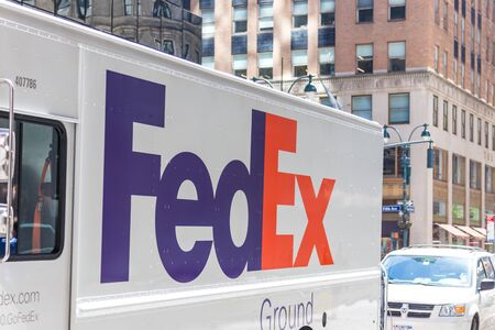 NEW YORK, USA - MAY 15, 2019: FedEx Express truck in midtown Manhattan. FedEx is one of leading package delivery services offering many different delivery options