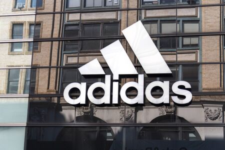 NEW YORK, USA - MAY 16, 2019: Adidas logo on a store front in Manhattan, New York