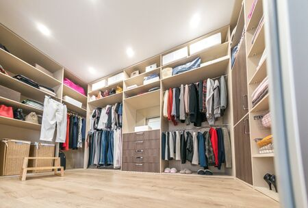Big wardrobe with different clothes for dressing room Stock fotó
