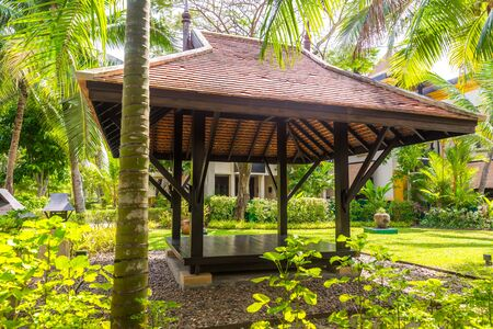 beautiful wooden gazebo and nice green lawn