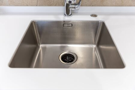 Stainless kitchen sink with food waste disposal in modern home Stockfoto