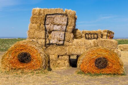 big hay and straw made tractor for decoration Stockfoto