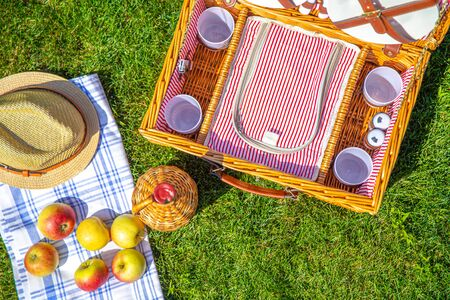 View from above on Picnic basket on green sunny lawn in the park