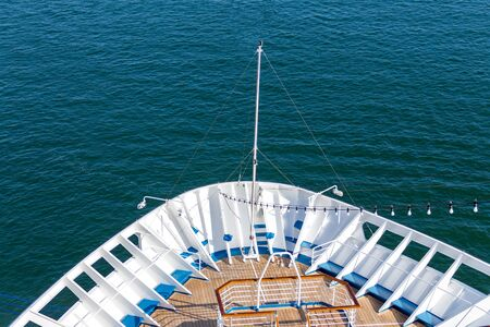 Cruise travel tourism concept - open deck with navigational equipment and pool nose ship cruise liner