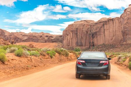 Offroading through the Monument Valley driving a car Banco de Imagens