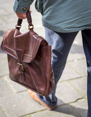 Closeup of man holding casual leather Briefcase Going To Work Banco de Imagens