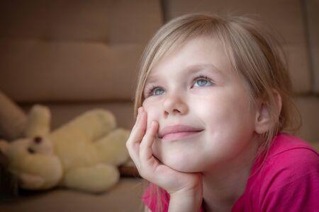 Closeup of a dreaming beautiful little girl