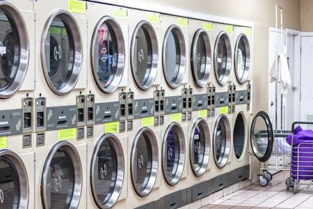 Miami, USA - September 09, 2019: industrial washing machines in a public laundromat, coin laundry service