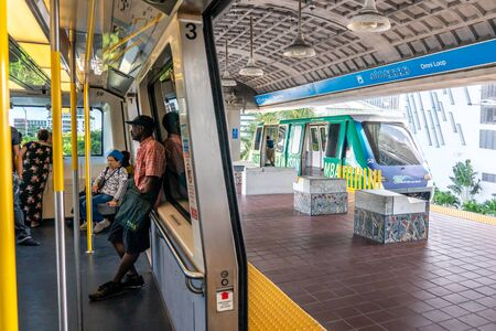 MIAMI, USA - September 10, 2019: Metro mover train on the station in Downtown Miami. Metro mover is a free automatic transport system in Miami 에디토리얼