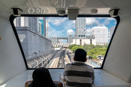 MIAMI - September 10, 2019: Father and son, view from inside of train in Miami downtown