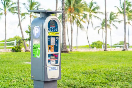 Miami, USA - September 10.09.2019: parking pay station with solar power