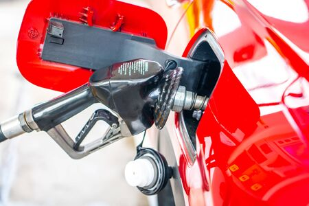 Car refueling on petrol station. Fuel pump with gasoline. Service is filling gas or diesel into tank