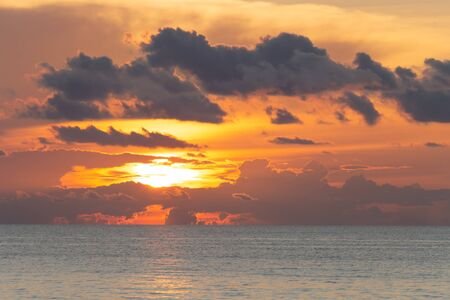 Beautiful dramatic cloudscape landscape sunset from the beach