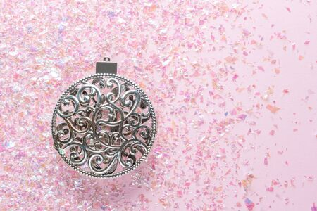 Vintage christmas tree decoration on pink glitter background. Minimal Christmas concept. Happy New Year. Flat lay, top view, copy space