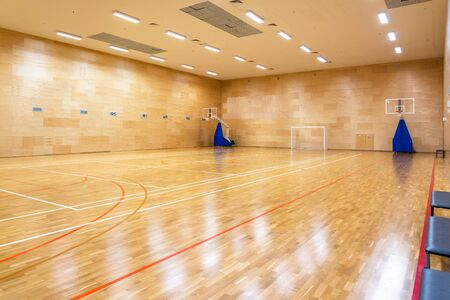 Interior of empty modern basketball or soccer indoor sport gymnasium Stock Photo
