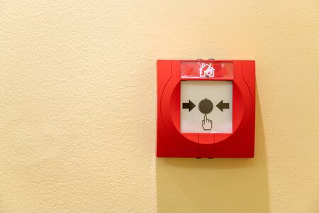 Push button switch fire alarm box on wall for warning and security system Reklamní fotografie