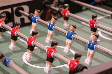 Soccer table game with red and blue players closeup