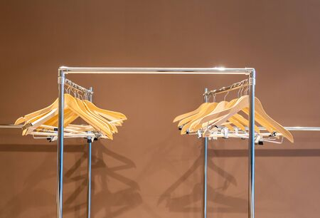 Hangers on metal rack with no clothes in cloakroom Stock Photo