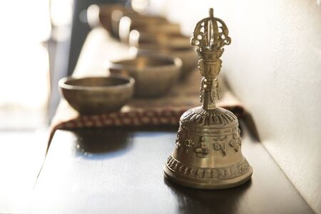 Accessories for sound massage. Tibetan singing bowls and bell for treatment