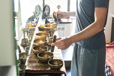 Tibetan singing bowls in sound therapy in spa center Stock fotó