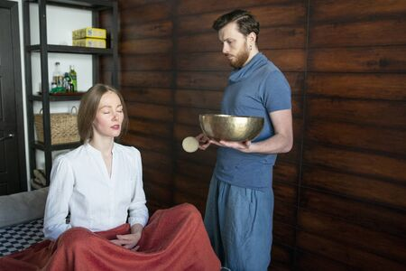 Tibetan singing bowls in sound therapy in spa center Stock Photo