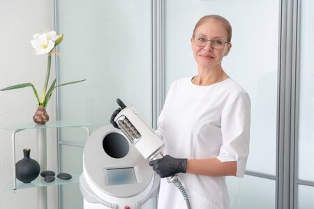 cosmetologist standing in rubber gloves doing endospheres therapy