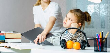 Mother Arguing With Teenage Daughter Over Online Activity taking away laptop