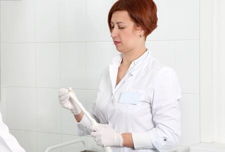 Gynecologist ready to do transvaginal ultrasound with wand and exam a woman Stock Photo