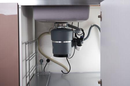 Garbage Disposal under the sink, waste chopper concept