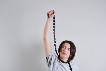 Suicide prevention concept, Depressed young woman holding metal chain around her neck
