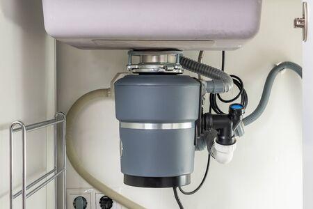 Garbage Disposal under the modern sink, waste chopper concept