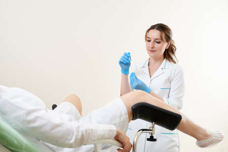 Gynecologist using vaginal swab for STD testing
