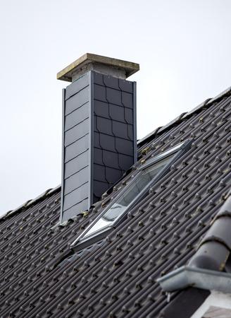 Roof with chimney, modern ceramic tile Banco de Imagens