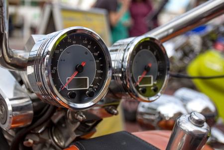 Chromed speedometer of classic design retro motorcycle closeup