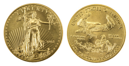 golden american eagle coins on white background
