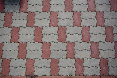 stone background. sidewalk red and gray pavement