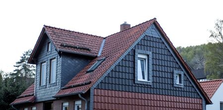 the roof of the house with  window