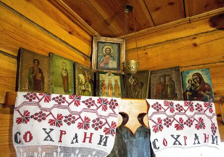 Orthodox icons on the wall in the corner of the house