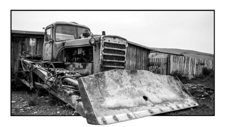 old russian tractor. black and white photo