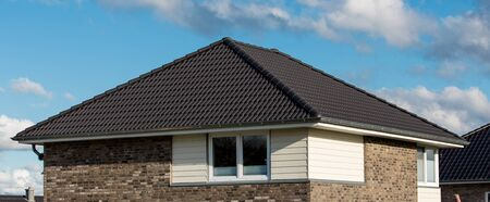the roof of the house with nice window under the blue sky Stock Photo