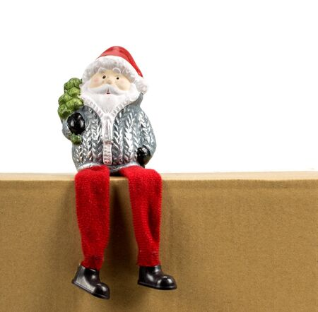 Santa Claus sits on a box