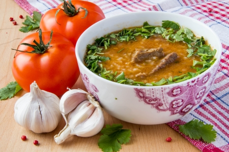 Oriental tomato soup with meat, rice and cilantro  photo