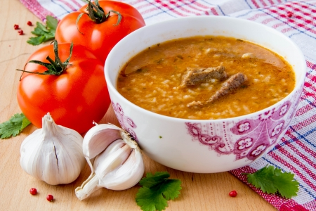 Oriental tomato soup with meat, rice and cilantro Stock Photo - 17896962